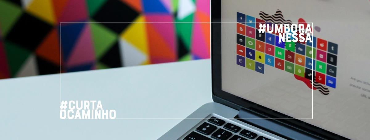 imagem de um computador com um design colorido na tela